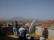 Installing a VSAT for the First Bcom project with the UNHCR in the Balkan region just after the Kosovo war where Bcom supplied VSAT terminals for voice communication of UN stations